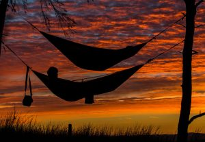 Hammocks in a sunset might help low back pain!